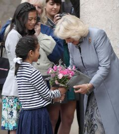 Camilla, the Duchess of Cornwall receives flowers from Meagan Gillis, 12, and her sister Jillian, 8, as the royal couple leaves the Assiniboine Park Pavilion Gallery Wednesday in Winnipeg.