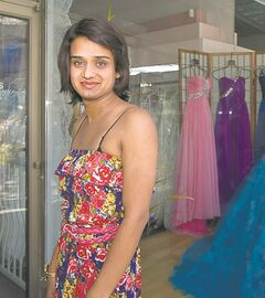 Rohit Singh poses for a photograph Saturday outside of Jenny's Bridal Boutique where she was not allowed to try on a wedding dress.