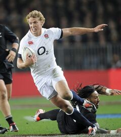 England's Billy Twelvetrees slips the tackle of New Zealand's Ma'a Nonu in the second international rugby test match at Forsyth Barr Stadium in Dunedin, New Zealand, Saturday, June 14, 2014. (AP Photo/SNPA, Ross Setford) NEW ZEALAND OUT
