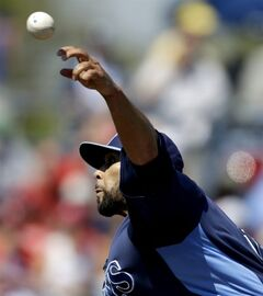 Tampa Bay Rays starting pitcher David Price throws during the first inning of a spring training baseball game against the Philadelphia Phillies, Friday, March 8, 2013, in Port Charlotte, Fla. (AP Photo/David Goldman)