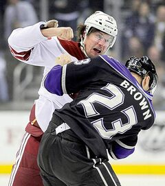 Coyote Shane Doan (left) and King Dustin Brown engage in a battle between captains.