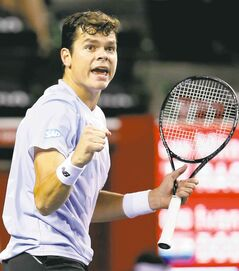 Milos Raonic of Canada wins a point against Ivan Dodig of Croatia during their semifinal.