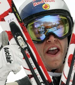 Canada's Erik Guay celebrates his third place after completing an alpine ski, men's World Cup downhill, in Val Gardena, Italy, Saturday, Dec. 15, 2012. Reigning world downhill champion Guay says he's feeling good as he prepares to defend his title at the world ski championships. THE CANADIAN PRESS/AP-Armando Trovati
