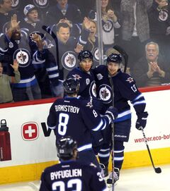 Winnipeg Jets' Evander Kane celebrates with Kyle Wellwood, Alexander Burmistrov, and Dustin Byfuglien after scoring his 25th goal (this one unassisted) to open scoring at the MTS Centre on Thursday.