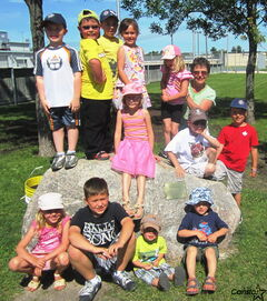 Virginia Robertson (back right) with some of her KWNS kids at the big rock which now bears a plaque in her honour.