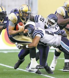 Winnipeg Blue Bombers starting quarterback Buck Pierce gets eviscerated by Toronto Argonaut Shane Horton late in the second quarter.