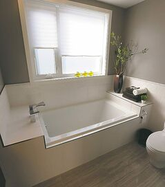The ensuite bathroom, with its soaker tub and heated floor, is the highlight of the master suite.