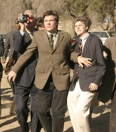 In this undated publicity photo originally released by Fox, Jason Bateman, center, and Michael Cera, right, are shown in a scene from the TV series