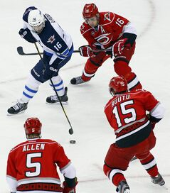 Winnipeg Jets' Andrew Ladd (16) battles with Carolina Hurricanes' Brandon Sutter (16), Tuomo Ruutu (15), of Finland, and Bryan Allen (5) during the second period of an NHL hockey game in Raleigh, N.C., on Friday.