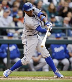 Kansas City Royals' Alcides Escobar singles against the Seattle Mariners in the third inning of a baseball game Friday, May 9, 2014, in Seattle. (AP Photo/Elaine Thompson)