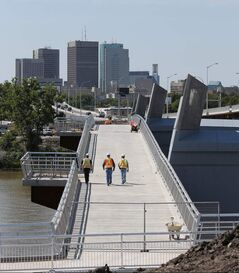 The pedestrian/cycling bridge spanning the Red River, built on the old Disraeli Bridge piers, will open mid-September.
