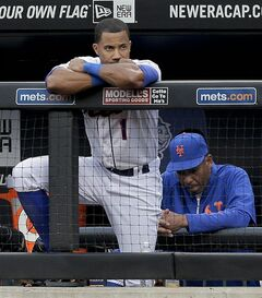New York Mets' Chris Young (1) watches from the dugout railing during the ninth inning of a baseball game against the Arizona Diamondbacks, Saturday, May 24, 2014, in New York. The Diamondbacks won 3-2. (AP Photo/Julie Jacobson)
