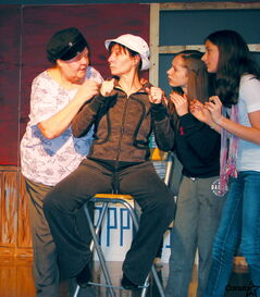 Veronica Black as the Skipper (left), Jenna Erb as Mary Anne and Carleigh Enns as Ginger encourage Gilly Gan, played by Allison Leonzio, in a rehearsal of Gilly Gan's Island.