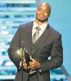 Adrian Peterson of the Minnesota Vikings accepts the AP Most Valuable Player award Saturday in New Orleans.
