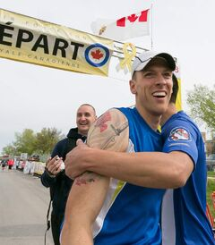 Cpl. Jean Francois Dion is congratulated at the end of his own double marathon at Sunday's RCAF run. The Afghanistan veteran ran a gruelling 85-kilometres over the Highway of Heroes from Portage la Prairie to raise awareness for the Canadian Forces Soldier On program, which helps ill and injured military members get back into fitness and sports. The run also benefits the Canadian Cancer Society.