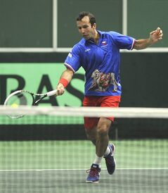 Radek Stepanek from the Czech Republic returns during his Davis Cup first round doubles match with Tomas Berdych against Robin Haase and Jean-Julien Rojer from the Netherlands in Ostrava, Czech Republic, Saturday, Feb. 1, 2014. (AP Photo,CTK/Jaroslav Ozana) SLOVAKIA OUT