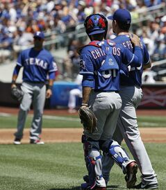 Texas Rangers catcher Robinson Chirinos (61) consoles starting pitcher Nick Tepesch (23) who allowed five runs in the first inning of a baseball game against the New York Mets in New York, Sunday, July 6, 2014. (AP Photo/Kathy Willens)