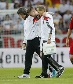 Germany's Marco Reus, center, leaves the pitch after he was injured during a soccer friendly match between Germany and Armenia in the Coface Arena in Mainz, Germany, Friday, June 6, 2014. (AP Photo/Michael Probst)