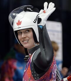Alex Gough of Canada waves to the crowd after finishing her third run during the women's singles luge competition at the 2014 Winter Olympics, Tuesday, Feb. 11, 2014, in Krasnaya Polyana, Russia. (AP Photo/Natacha Pisarenko)
