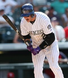 Colorado Rockies' Troy Tulowtizki reacts after striking out with two runners on base, against the St. Louis Cardinals in the ninth inning of the Cardinals' 9-6 victory in a baseball game in Denver on Wednesday, June 25, 2014. (AP Photo/David Zalubowski)