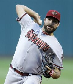 Arizona Diamondbacks starting pitcher Josh Collmenter delivers in the first inning of a baseball game against the Cleveland Indians, Tuesday, Aug. 12, 2014, in Cleveland. (AP Photo/Tony Dejak)