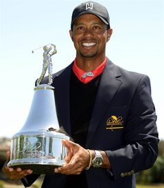 Tiger Woods holds the championship trophy after winning the Arnold Palmer Invitational golf tournament in Orlando, Fla., Monday, March 25, 2013. Woods won with a score of 13-under-par.(AP Photo/Phelan M. Ebenhack)