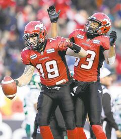 larry macdougal / the canadian press Stampeders QB Bo Levi Mitchell (left) and Romby Bryant celebrate Bryant's TD against Saskatchewan.