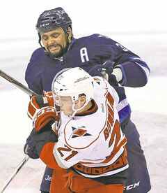 Dustin Byfuglien, tussling with 'Canes' Drayson Bowman Saturday, isn't worried about a trade.