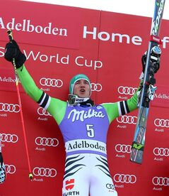Felix Neureuther of Germany celebrates on the podium after winning an alpine ski, men's World Cup giant slalom in Adelboden, Switzerland, Saturday, Jan. 11, 2014. (AP Photo/Giovanni Auletta)