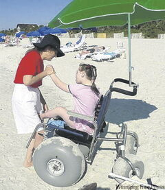 Mary - and others who use wheel­chairs - can fully enjoy the beach courtesy of a beach wheelchair.