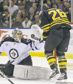 Jets� goalie Ondrej Pavelec snares the puck before Buffalo Sabres� Thomas Vanek can pounce. Pavelec stopped 31 of 32 shots Saturday night.
