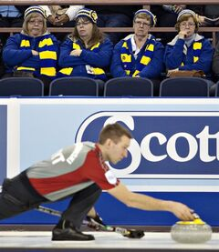 Curling fans watch as team Northwest Territories/Yukon's Brad Chorostkowski throws a rockduring the first draw at the Tim Hortons Brier in Edmonton, Alta., on Saturday March 2, 2013. THE CANADIAN PRESS/Jason Franson.