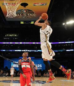 Team Webber's Anthony Davis of the New Orleans Pelicans heads to the basket as Team Hill's Bradley Beal of the Washington Capitals look son during the Rising Star NBA All Star Challenge Basketball game,, Friday, Feb. 14, 2014, in New Orleans. (AP Photo/Bob Donnan, Pool)