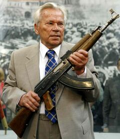 In this July 6, 2007 file photo, Mikhail Kalashnikov holds his AK-47 Nr.1, a prototype of the famous AK-47 rifle, during a ceremony to mark the 60th anniversary of the worldwide assault rifle's creation in the Russia's Armed Forces Central Museum in Moscow.