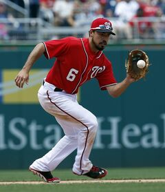 Washington Nationals third baseman Anthony Rendon fields a ball hit by Texas Rangers' Michael Choice, who was out at first on the play, during the eighth inning of a baseball game at Nationals Park Saturday, May 31, 2014, in Washington. The Nationals won 10-2. (AP Photo/Alex Brandon)