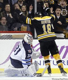 Boston Bruins' Nathan Horton celebrates after scoring on Winnipeg Jets goaltender Ondrej Pavelec in the third period Tuesday.