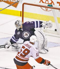 Carolina's Chad LaRose pots the winner on Ondrej Pavelec in the Jets' 4-3 loss to the lowly Hurricanes on Sunday.