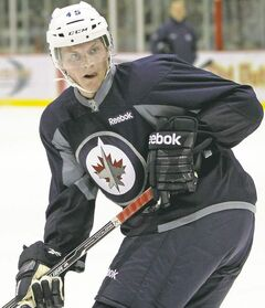 Jacob Trouba begins his NHL apprenticeship  when he arrives in Winnipeg today.