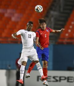 Ghana's Jordan Ayew (13) and South Korea's Joengho Hong (2) battle for the ball during the second half of an international friendly soccer match in Miami Gardens, Fla., Monday, June 9, 2014. Ghana won 4-0. ( AP Photo/J Pat Carter)