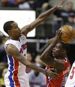 Los Angeles Clippers point guard Darren Collison (2) looks to pass around Detroit Pistons point guard Brandon Jennings (7) during the first half of an NBA basketball game in Auburn Hills, Mich., Monday, Jan. 20, 2014. (AP Photo/Carlos Osorio)