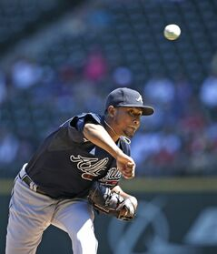 Atlanta Braves starting pitcher Julio Teheran throws against the Seattle Mariners in the first inning of a baseball game Wednesday, Aug. 6, 2014, in Seattle. (AP Photo/Elaine Thompson)