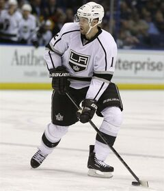 FILE - In this Feb. 11, 2013, file photo, Los Angeles Kings' Simon Gagne handles the puck during the third period of an NHL hockey game against the St. Louis Blues in St. Louis. The Kings traded struggling left wing back to the Philadelphia Flyers on Tuesday, Feb. 26, 2013, for a conditional draft pick. (AP Photo/Jeff Roberson, File)