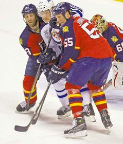 Florida�s Mike Weaver (left) and Ed Jovanovski put the squeeze on Winnipeg�s Antti Miettinen during first-period action in Sunrise, Fla., Tuesday.