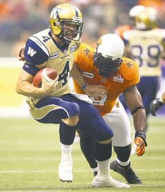 Winnipeg Blue Bombers' quarterback Buck Pierce, left, is sacked by B.C. Lions' Keron Williams during the first half of a CFL football game in Vancouver, B.C., on Friday June 29, 2012. THE CANADIAN PRESS/Darryl Dyck