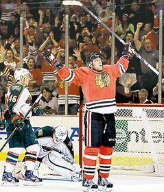 Chicago's Marian Hossa celebrates his second goal Thursday night.