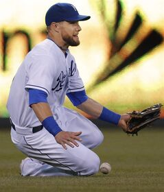 Kansas City Royals left fielder Alex Gordon fails to catch a fly ball hit by Chicago White Sox's Adam Eaton during the fifth inning of a baseball game at Kauffman Stadium in Kansas City, Mo., Tuesday, May 20, 2014. Eaton doubled on the play. (AP Photo/Orlin Wagner)