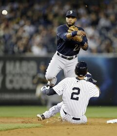Seattle Mariners' Robinson Cano (22) throws out New York Yankees' Carlos Beltran at first base after forcing out Derek Jeter (2) during the third inning of a baseball game Thursday, May 1, 2014, in New York. (AP Photo/Frank Franklin II)
