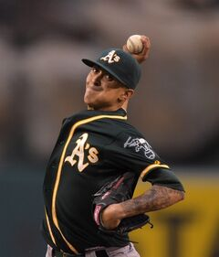 Oakland Athletics starting pitcher Jesse Chavez throws during the second inning of a baseball game against the Los Angeles Angels, Monday, June 9, 2014, in Anaheim, Calif. (AP Photo/Mark J. Terrill)