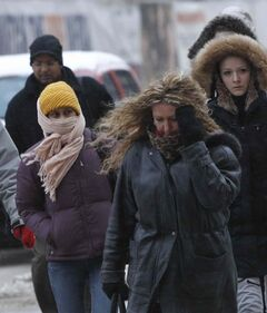Pedestrians in downtown Winnipeg endure the cold winds blowing Wednesday morning.