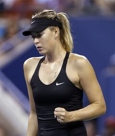 Maria Sharapova, of Russia, reacts after defeating Maria Kirilenko, of Russia, 6-4, 6-0 in the opening round of the U.S. Open tennis tournament Monday, Aug. 25, 2014, in New York. (AP Photo/Darron Cummings)